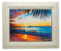 A framed tile with a painting of a west coast sunset in Barbados by Jill Walker.