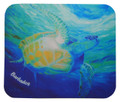 A mousepad with a turtle swimming up towards the surface by Sue Trew