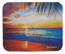 A souvenir mousepad with a painting of a sunset on the west coast of Barbados by Jill Walker