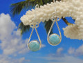 Larimar and silver decorative drop earrings.
