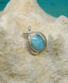 A larimar and silver pendant.