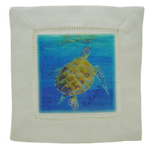 A cocktail napkin with a turtle surfacing.
