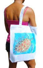 A tote bag with a Sue Trew design.
