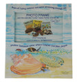 A Calypso Conch photo frame, part of the Turtle Tracks Family of books and plush toys.