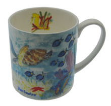 Bone china mug with a reef scene with turtles and sting rays.