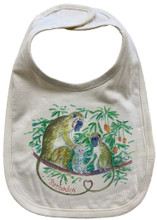 A natural bib with monkeys on the front
