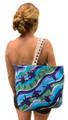Canvas bag with turtle hatchling design.