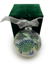 A glass Christmas Ball hand painted all around.
