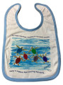 A cotton bib with blue trim.