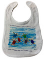 A cotton bib with the happy hatchlings design and white trim.
