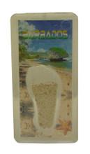 A magnet with an image of Bathsheba Rocks in Barbados and some Barbados sand.
