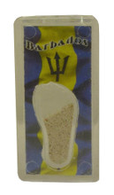 A magnet with an image of the Barbados flag and some Barbados sand.