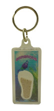 A keychain with an image of a diver in Barbados and some Barbados sand.