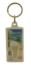 A keychain with Barbados sand and an image of Bathsheba Rocks.
