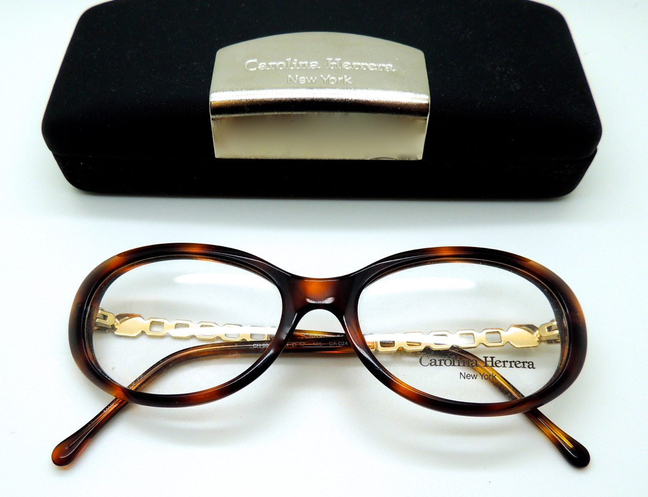 3312d1dc219 Womens Carolina Herrera CH 506 Vintage Oval Turtle Acrylic and Gold Metal  Designer Glasses
