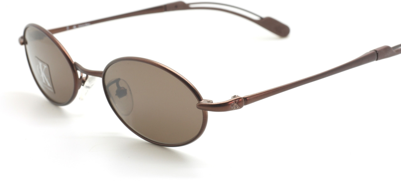 1b8fabf0dc4 Vintage Small Oval Sunglasses By Calvin Klein 2017 RX In A Bronze ...