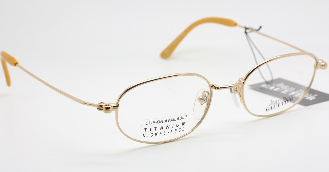 4c7fba7b31c Titanium Jean Paul Gaultier 0027 Oval Shaped Brilliant Vintage Eyeglasses  In An Soft Gold Finish