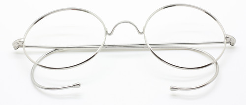 Vintage Style True Round Glasses With Saddle Bridge And Curlsides At www.theoldglassesshop.co.uk