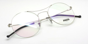 Les Pieces Uniques MARGOT round eye glasses  in silver from www.theoldglassesshop.co.uk