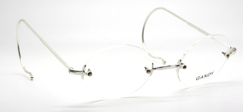 Gandy Rimless Almost Round Glasses With Curlsides & Saddle Bridge At www.theoldglassesshop.co.uk