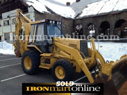 4x4 Caterpillar 446B Backhoe Loader with hydraulic thumb, in very good condition.