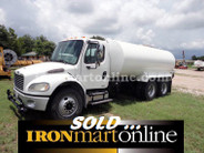 2005 Freightliner M2 4,000-Gallon Water Truck, powered by CAT C7 300HP Diesel Engine.