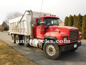 1998 350 hp R-Model Mack Tri Axle Dump Truck, features a 15.5-foot aluminum dump bed.