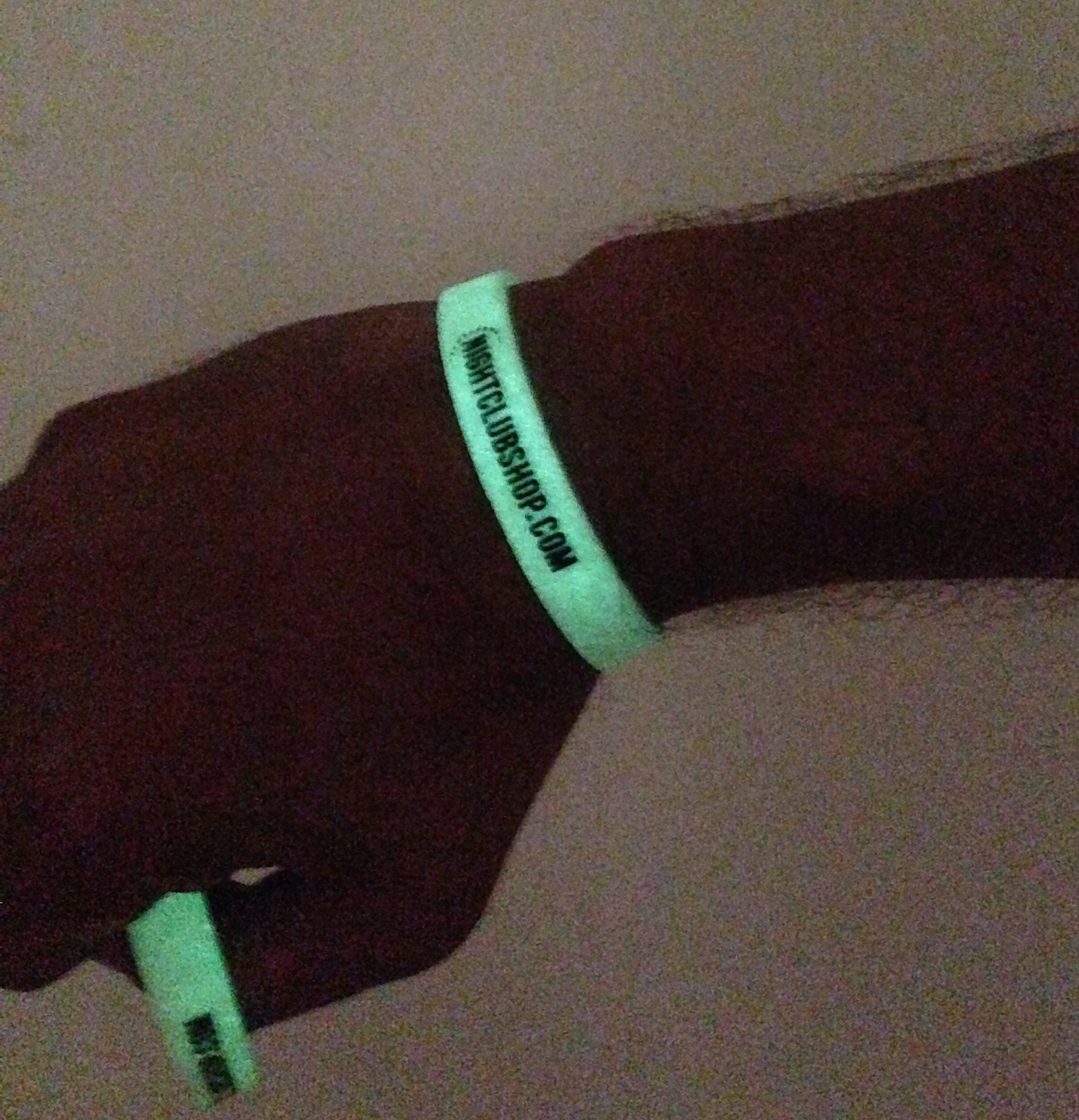 actual-picture-real-custom-glow-debossed-wristbands-nightclub-shop-glowing-.jpg