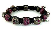 Pink Crystal Beads and Black Gold Skull Bead Bracelet (Clear-Coated)
