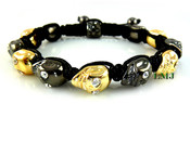 Black and Yellow Gold Skull Bead Bracelet