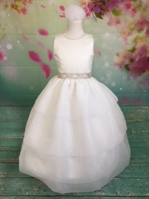 We are proud to feature Christie Helene's Couture Collection of custom communion dresses. Each dress is custom made to perfectly fit your child. The Couture Collection dresses are made with the finest materials including raw silk, taffeta, and/or bridal satin and embellished with embroidery, pearls, sequins and/or crystals. Please call us at 1.800.523.7604 for instructions on measuring your child and allow 8 to 10 weeks for delivery. Half sizes are available at an additional cost.