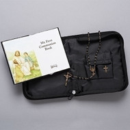 "Boy's Communion folder set. This zippered leatherette case set includes a mass book, a cross pin, & rosary.  The communion folder measures 5""H x 1-1/2""D x 6.5""W"