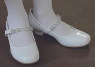 "Mia Shoe. A shiny white comfortable shoe with a 1"" heel.  Rhinestone studded strap has a hook and loop closure."