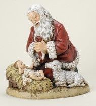 "Kneeling Santa with Lamb Figure. Resin/Stone Mix. Dimensions: 13""H x 13""W x 10""D"