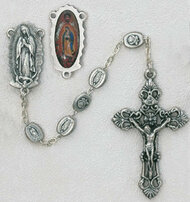This Rosary has an image of Our Lady of Guadalupe as its center with metal beads that have the image of Our Lady of Guadalupe on one side and a Rose on the other.