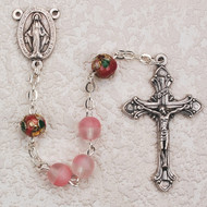 Pink beaded rosary with red cloisonne Our Father beads. Deluxe Crucifix and Center MM. Comes in gift box.