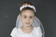Wreath Veil has silk floweres with rhinestone centers. Pearl leaves with tulle bow. Back satin flower and streamers.