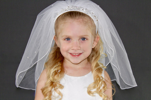 Headband Veil. Ornate satin headband with two layers of tulle. Accents include pearl and rhinestone flowers.