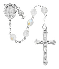 Deluxe Crystal Communion Rosary with a rhodium miraculous medal center, tiny chalice charm and crucifix. Comes in a white leatherette gift box.