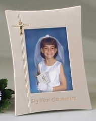 "This 9"" x 11"" First Communion picture frame is beautiful and a great way to remember your child's First Communion.  This ivory colored picture frame is adorned with a cross etched into the left side of the frame and a chalice placed in the middle of the cross and holds a 4 x 6"" photograph. The words ""My First Communion"" are etched in gold colored writing at the bottom of the frame."