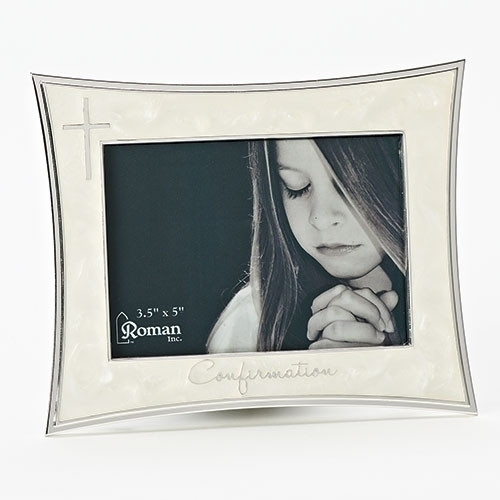 "5.5""H Ivory Confirmation Frame from the Caroline Collection. Holds a 4"" x 6"" picture. Adorned with a silver cross on left side and the word ""Confirmation"" across the bottom of frame. Zinc alloy, lead free. Holds a 5""W x 3 1/3""H photo"