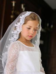 Mantilla Style Communion Headpiece. Thick lace scalloped edge around entire veil. Lays flat on head.