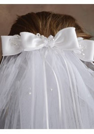 The barrette attaches to the hair in the back and features a double bow which has elegant pearl stem accents included in the center of the bow. The attached veil falls in layers and hangs down below the shoulders.