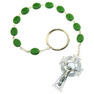 This little one decade Rosary is a replica of the single-decade rosary used in Ireland in the Penal days when it was forbidden to practice the Catholic Faith in Ireland.  Plastic beads with Shamrock imprint.