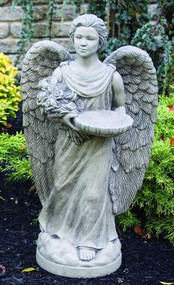 """This beautiful angel statue with a bird feeder is from our Devotional collection. This statue features an angel holding a bouquet of roses and a bowl that can be used as a bird feeder. This statue comes in a natural cement finish only, making it beautiful and simple.  Details:  Dimensions: 28""""H x 15.5""""W x 9.25""""BD 74 lbs Natural finish Made to order.  Allow 34-6 weeks for delivery Made in the USA"""