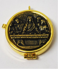 "Eucharistic Teca ""Last Supper"" with bronze-colored relief plaque. Complete with ring to hang it on the neck. Measures 2"" round x 1/2""H"