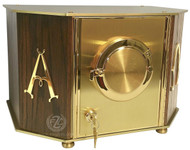 "Exposition Tabernacle Style 7130 Tabernacle brings an attractive and high quality made element to you altars repertoire. Made from a combination of Brass and Oak with polished Brass Alpha, Omega symbols. A satin inside lining has a linen texture contact material. Luna hold 2 3/4"" host. Key with key lock. The Exposition door has an engraving of IHS. Holds 2 3/4"" host.  Outside Dimensions: 15 5/8"" wide, 10 1/2"" depth, 10"" high. Inside Dimensions: 13 1/2"" wide, 8 1/2"" depth, 9"" high. Brass feet stand 1/4"" high"
