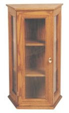 "Solid Oak with Glass Panels. Adjustable wood or glass shelves. Brass lock. Dimensions: 31"" height, 17"" width, 10"" depth"