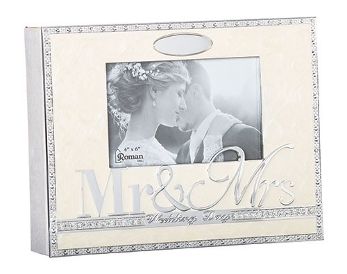 """From the Caroline Collection this beautiful wedding photo album holds 156 4"""" x 6"""" photographs. The album measures 8.5"""" in hieght. Made of zinc alloy. Lead free"""