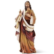 """Sacred Heart of Jesus 6.25"""" Statue is made of a resin/stone mix. Dimensions:  6.25""""H 2.5""""W 2""""D"""